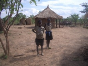 Malawi children with huts_0